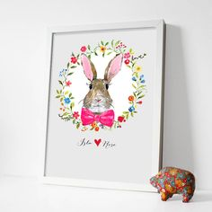 A beautiful hand-painted bunny rabbit print which can be personalised as a lovely gift or for your own home.This design can be personalised with a name. This would make a gorgeous, memorable birthday or new baby gift, and is perfect for newborn Easter babies thanks to the cute bunny rabbit. The colours we use are vibrant so will easily compliment any room, and being hand-painted it has a real personal touch. Why not send something that you can keep and treasure forever?Printed on premium…