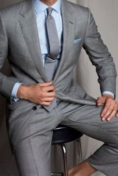 light gray suit with a blue shirt is a comfortable go-to look