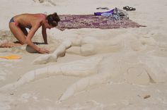 Working with sand at Railey Beach, Thailand.