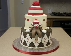 Great sock monkey themed cake. The patterns and the beany hat topper are extremely cool.