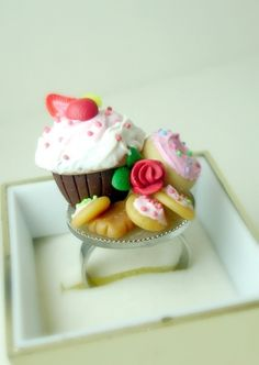 Polymer clay tea party sweets ring...now that's a miniatures ring! (DIVINEsweetness on etsy)