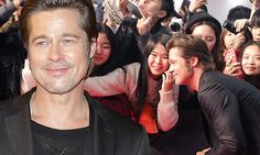 Friendly Brad Pitt takes selfies with his fans at Seoul Fury premiere