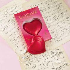 Godiva chocolate hearts on sheet music.
