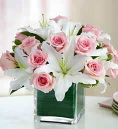 Contemporary elegance meets classic style in the Modern Embrace Pink Rose & Lily Cube bouquet from 1-800-Flowers.com. Gorgeous fresh pink roses share the stage with showy white lilies, hand-designed and arranged in a compact style and gathered in a chic cube vase lined with exotic ti leaf ribbon. This stunning arrangement comes in three sizes, and right now you can register to win one of ten $100 1-800-Flowers.com gift cards