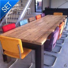 Industriële Balkentafel met Retro Rib Stoelen - Complete vergader- en eettafelsets met stalen H-balk onderstel en gekleurde Retro Rib buisframestoelen. Stijlvolle en comfortabele set voor in elke vergaderruimte, kantine of woonkamer. Nu te verkrijgen als complete set inclusief retro buisframe stoelen. De stoelen zijn bekleed met retro ribstof en hebben dankzij de zachte kussens een hoog comfort. De tafel is gemaakt van oude sloophouten balken die hoogwaardig zijn afgewerkt met een Woodfix…