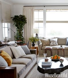 Perfect Family room.  Herringbone rug, industrial lighting & stools, deep couches for lounging and an organic coffee table.