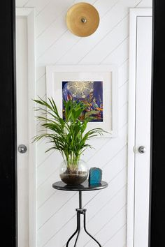 thisoldhouse.com | from 9 Creative Low-Cost Upgrades From Our Favorite Bloggers  Horizontal planks on bottom half of hallway maybe?