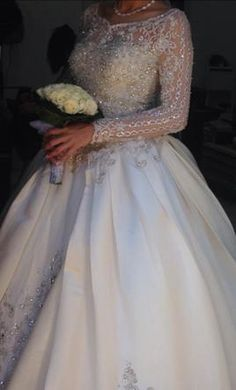 Beaded long sleeve wedding dresses fit for a princess are obtainable. Find all sorts of wedding gown ideas at www.dariuscordell.com Custom designs & replicas of haute couture wedding dresses available. We can replicate any dress from a picture. Contact us for pricing and details.