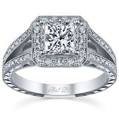 Split shank halo engagement ring with princess cut center stone. The hand-engraving and milgrain detailing is vintage-inspired.