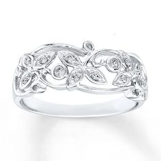 An enchanting leaf and vine motif unfurls along this sterling silver ring for her. Diamonds totaling 1/15 carat in weight add sparkle to the airy design. Diamond Total Carat Weight may range from .065 - .08 carats.