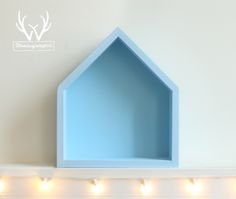 Charming нouse-shaped shelf in blue color.