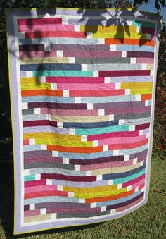 Beautiful strip quilt!! I love this. Directions given. Since I'm looking for denim options, I could do this in denim.
