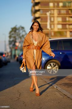 News Photo : Landiana Cerciu wears a brown long coat with. Daily Street Style, Alberta Ferretti, Mesh, Brown, Coat, How To Wear, Outfits, Dresses, Fashion