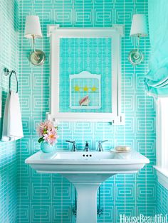 In a New Jersey beach house's small bathroom, designer Mona Ross Berman used a loud geometric wallpaper in bright ocean blue.
