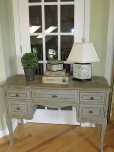 Antique desk painted with Annie Sloan Chalk paint color Paris Grey then clear wax, followed by dark wax