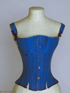 PEACOCK BLUE SILK CORSET, 19th C, Heavily boned, brass busk, 35 back lacing eyelets, blue embroidered flossing, coarse linen lining, front ties on shoulder straps