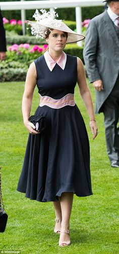 Princess Eugenie was the picture of elegance in her navy dress with pink waistband and col...