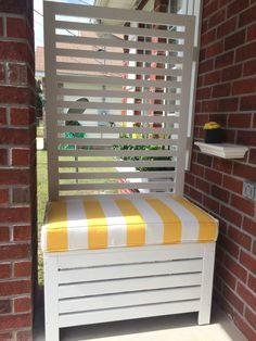 Outdoor privacy screen bench. Ikea Applaro. I painted it white and had a cushion made from cushion source. It has storage underneath. Portable, perfect for balcony too.