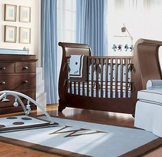 Baby blue and brown nursery