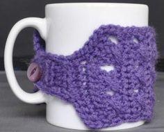 crossed stitch mug cosy
