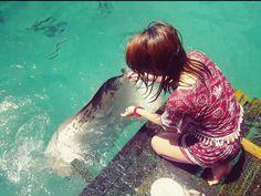 Feeding Brenda the stingray.  Sibadan Cage, Hinatuan, Surigao Del Sur Philippines