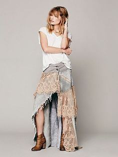 Abbie's Limited Edition Skirt | Distressed washed denim maxi skirt with intricate crochet overlay and crochet ruffle trimming. Crisscross wrap design in the front with button closure at front side of waist. Bottom hems are raw edge and gently frayed.