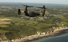 Military escort: An Osprey accompanies Marine One carrying President Barack Obama over the beaches of Normandy