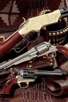 Love the Historic Firearms - Rifle is either an 1873 Winchester or a Henry rifle (can't see enough of it), a Remington revolver and a Colt Single Action Army.