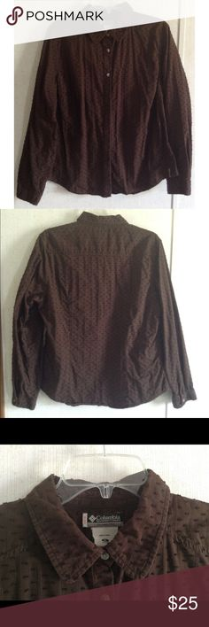 """Columbia Swiss Dot Brown Blouse Good condition. Little to no wash wear. Some loose threads. Really nice Columbia XCO """"Clover Creek"""" blouse. Buttons all the way up the front, some hidden under a panel. Textured fabric with stripes and little swiss dots. Rounded collar. Long sleeves with buttoning cuffs. Brown color called Bark. Size extra large. All offers welcome Columbia Tops Button Down Shirts"""