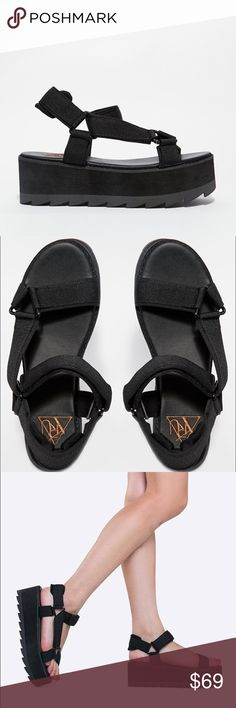 """• YRU • Pulse Lo Platform Sandal Rock an edge-driven look in these too-hot sandals. Chunky flatforms have fabric-made straps that velcro at the ankle. Synthetic upper, synthetic soleMeasurements approx Heel 2. 25"""" non-skid sole and cushioned footbed. Fit Runs true to size. YRU Shoes Sandals"""