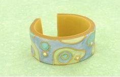 Swirled Cuff Bracelet   AllFreeJewelryMaking.com