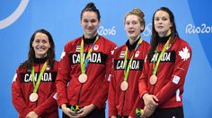 The Canadian women's 4x100-metre freestyle relay team, left to right, Sandrine Mainville, Chantal van Landeghem, Taylor Ruck and Penny Oleksiak receive their bronze medal at the 2016 Summer Olympics, in Rio de Janeiro, Brazil, Saturday, Aug. 6, 2016. THE CANADIAN PRESS/Frank Gunn
