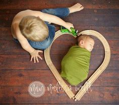 Sibling photos; Hunter would do this with his cars or monster trucks!