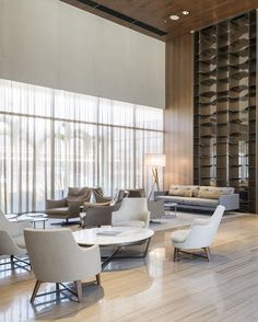 Whether you have a grand and comfortable lobby or a minimalistic and intimate one, all the elements of your hotel lobby design must be in total harmony. Hotel Lobby Design, Luxury Hotel Design, Luxury Home Decor, Luxury Interior, Interior Design, Luxury Hotels, Design Interiors, Lounge Design, Design Entrée
