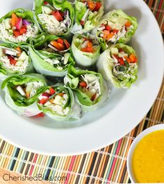 FRESH SPRING ROLLS with a SPICY CARROT GINGER SAUCE These fresh spring rolls are a wonderful, healthy lunch or dinner option. To top it off there is a yummy spicy carrot ginger sauce to compli...