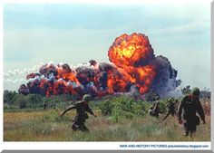 A napalm strike erupts in a fireball near U.S. troops on patrol in South Vietnam in 1966 during the Vietnam War. (AP Photo)