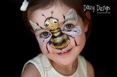 Pintura facial infantil por Christy Lewismaquiagem de abelha