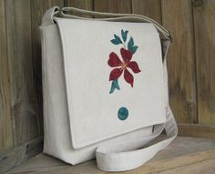 There is an elegance to the graceful clematis flower which is appliqued onto the flap of this crossbody bag.  Made from a remnant of suede-effect upholstery fabric, it is an attractive bag for the spring or summer.