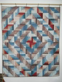 Strip sets, cut into squares, layer and sew into half square triangles. Deceptively simple.