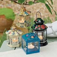 £34.99 Set of 4 Canal Ware Lanterns Set of 4 mini lanterns, hand-painted with motifs echoing 19th-century canal ware decoration.