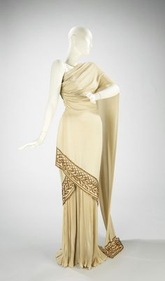 grecian white cream beaded one shoulder long column gown dress Evening dress Mme. Eta Hentz (American, born Hungary) Date: spring/summer 1944 Culture: American Medium: synthetic, Moda Fashion, 1940s Fashion, Vintage Fashion, Trendy Fashion, Vintage Vogue, Vintage Gowns, Vintage Outfits, Vintage Clothing, Greek Clothing