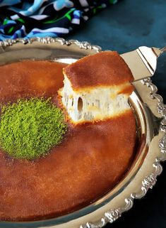 A perfected homemade version of the Levant specialty! Delicately crunchy smooth knafeh crust, cradling a molten layer of ooegy gooey cheese. A drizzle of scented sugar syrup, adds the finishing sweet touch to the classic favorite! Plus...recipe VIDEO included!
