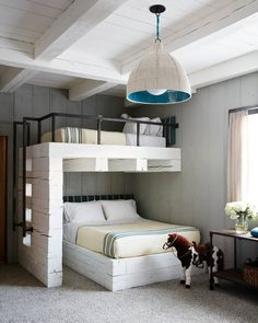 These bunk beds made of reclaimed, whitewashed wood are one part sweet, one part sophisticated.
