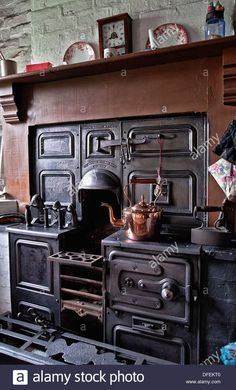 Cast iron open fire cooking range from the Black Country Living Museum Dudley West Midlands England UK Stock Photo. (Then look at what the Americans were cooking on 20 years later - it beggars belief) Antique Kitchen Stoves, Antique Stove, Antique Cast Iron Stove, Antique Kitchen Cabinets, Tv Cabinets, Victorian Kitchen, Vintage Kitchen, Alter Herd, Black Country Living Museum