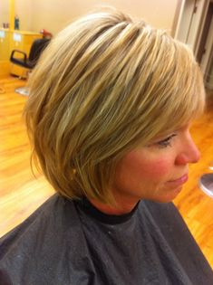 Gorgeous highlights by Mitzi Bishop at Bishops Salon and Day Spa. First we covered her grey then did a partial highlight with Aveda bleach. She has fine hair, so it works better as a short layer bob.