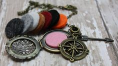 Essential Oil Diffuser Necklace- Aromatherapy Necklace- Antique Bronze Compass with Arrow Diffuser Necklace-Compass Arrow Travel Wanderlust  Would you love to have your favorite essential oils diffusing right under your nose? My essential oil diffuser necklaces allow you to have just that, and have a stylish statement piece at the same time! With trendy compass and arrow charms to show off your wanderlust.....pair with colorful felt pads in the locket to make even more of a statement!  The…