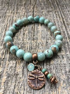 SOAR Robin& Egg Blue Agate adorned with an antique copper dragonfly charm, custom beaded charm and a tiny blue patina coin. Rustic Jewelry, Boho Jewelry, Jewelry Crafts, Beaded Jewelry, Jewelery, Jewelry Bracelets, Handmade Jewelry, Jewelry Design, Fashion Jewelry