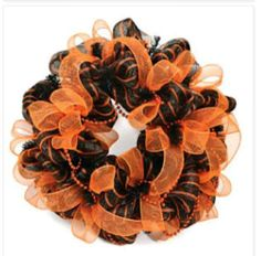 Love this Halloween color mesh wreath,  the beads top it off!