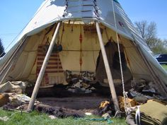 Since tipi dwellers lived a nomadic lifestyle and moved as the buffalo herds moved, furnishings had to be light and durable.   Backrests made of willow branches that had been dried and straightened functioned as chairs. These chairs were leaned against carved tripods to hold them in place.
