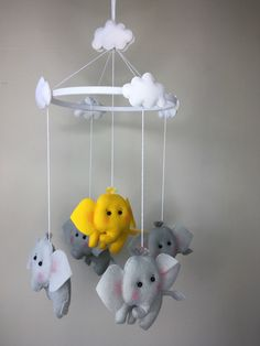 Baby Mobile,Elephants and Clouds,Cot Mobile,Crib Mobile,Nursery Decor,Baby Shower Gift,Unique Gift by feltncuddles on Etsy https://www.etsy.com/listing/387562364/baby-mobileelephants-and-cloudscot